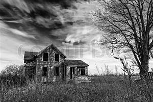 Black and white photo of an old scary abandoned farm house ...