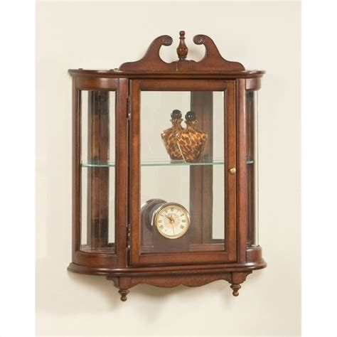 decorative wall curio cabinets butler specialty wall curio in plantation cherry finish