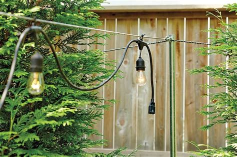 how to hang string lights on fence how to hang string lights