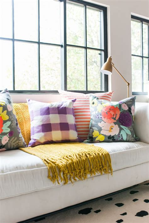 white sofa with colorful pillows interior inspiration caitlin wilson textiles with love
