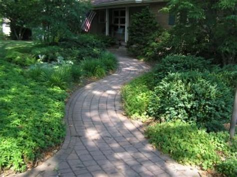 curved garden path curved brick path winding thru front yard still wide and direct to front door curb appeal