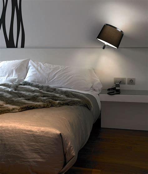 chrome wall light with black tiltable shade