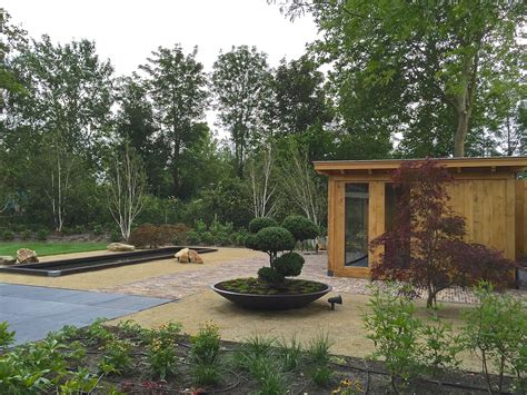 tuin spiegel blokker moderne landelijke tuin met maatwerk overkapping in