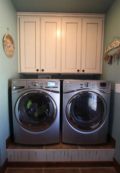 cabinets over washer and dryer affordable custom cabinets showroom