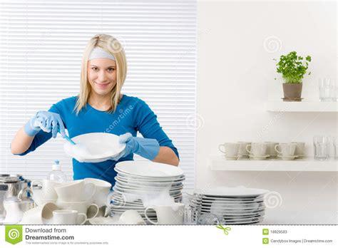 modern kitchen happy woman washing dishes stock