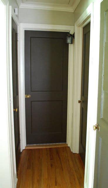 small hallway dark doors white trim downstairs living
