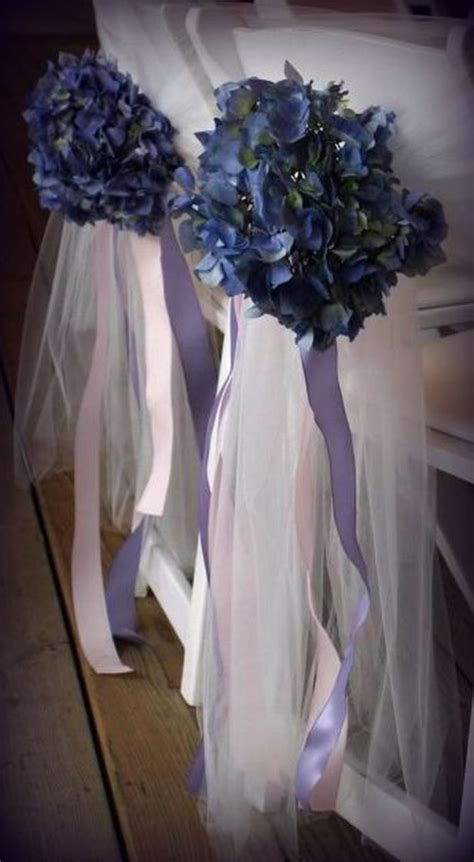 Chairs With Chair Covers And Sprays Of Blue Flowers And