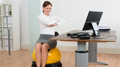 exercise while sitting at desk 8 exercises you can do while sitting at your desk
