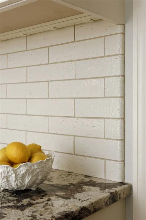 kyoto beige gloss brick tile  matching bullnose creates  clean  rustic backsplash note