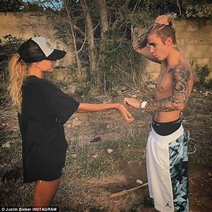 Justin Bieber Wraps His Arm Around Bikini Clad Hailey