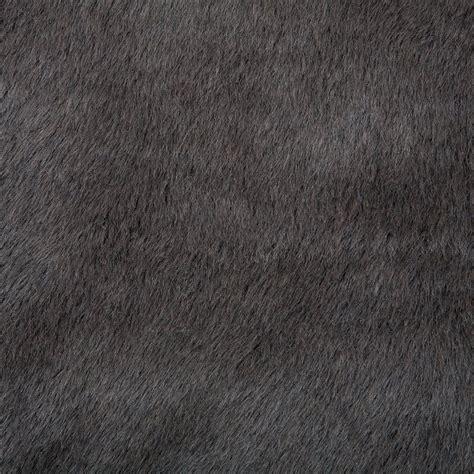 tapis pilepoil en fausse fourrure forme papillon tapis