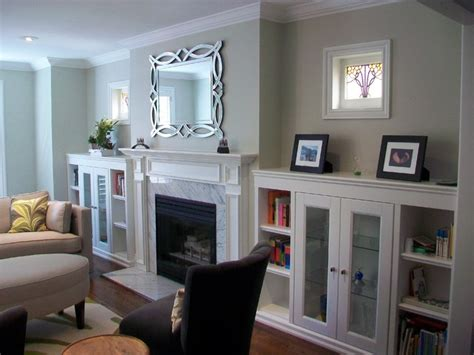 built  cabinets flanking fireplace