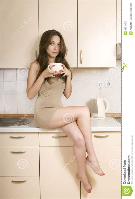 girl holding  cup   kitchen stock photography
