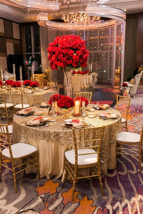 Gold Tables Topped With Tall Red Rose Centerpieces Las