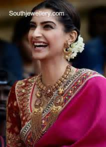 peacock design earrings in gold sonam kapoor in traditional gold jewellery jewellery designs
