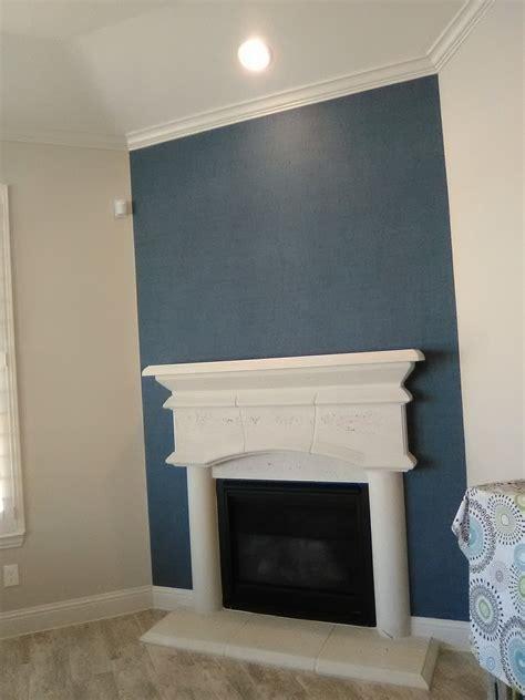 beautiful faux grasscloth sets   fireplace wall