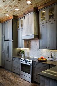 brick backsplash kitchen with pendant lighting and