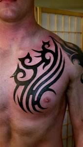 Fine Black Ink Tribal Chest Tattoo | Tattooshunt.com