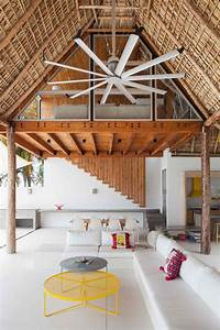 Colorful tropical open home with rough cut thatched roof for Interior decoration living room roof