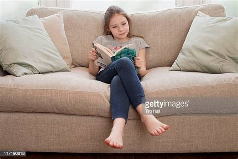 Kids Barefoot On A Sofa Photos and Premium High Res ...