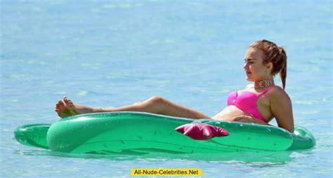 Tallia Storm in pink bikini on a beach in Barbados