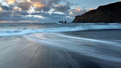 Sea stacks of Reynisdrangar at sunrise from the black ...