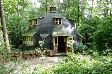 brown  white wooden house  green forest  stock