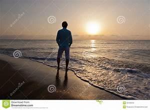 Man Alone On Beach Watching The Sunset Stock Photo - Image ...