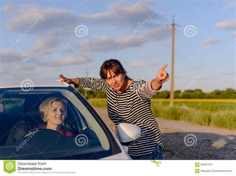 woman giving directions   lost driver stock photo image  stranger evening