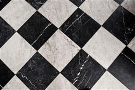 black  white checkered marble floor pattern stock photo