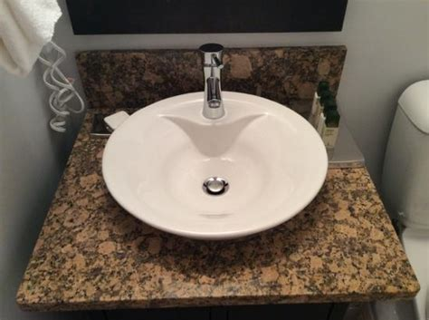 vessel sinks and granite countertops in bathrooms