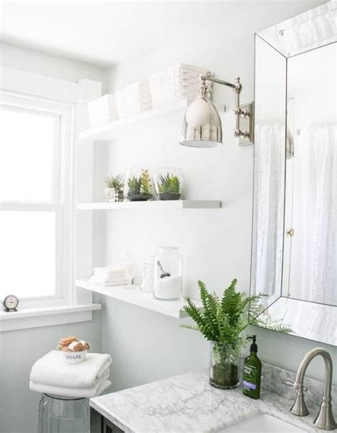 Glossy Pure White Furniture With Chic Fresh Bathroom Plant