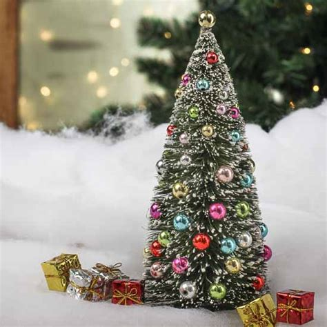 decorated frosted christmas tree frosted bottle brush christmas tree table shelf decorations christmas and winter holiday