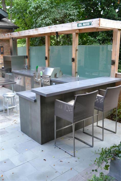 backyard sanctuary  bar area  concrete countertops