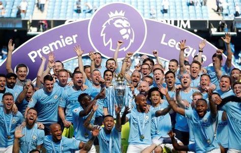 champions man city held  home  huddersfield town