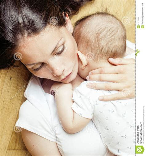 Happy Mother And Toddler Son In Bed Stock Photo