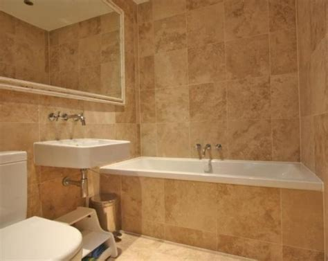 tiled bathroom photo of modern beige brown orange bathroom with mirror