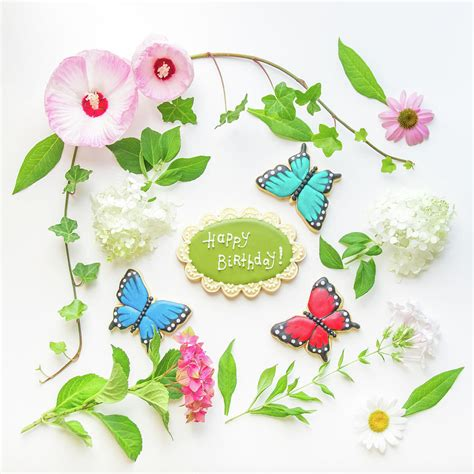 colorful flowers birthday cookie and butterfly s photograph by irina moskalev