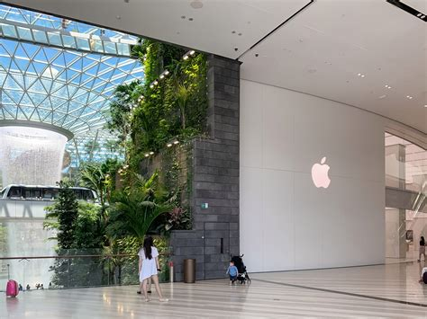 sweeping glass facade  apple jewel changi airport