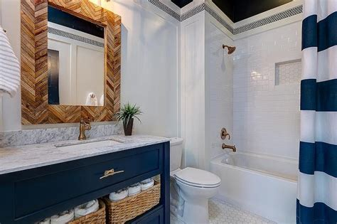 white and blue bathroom boasts a blue vanity adorned with