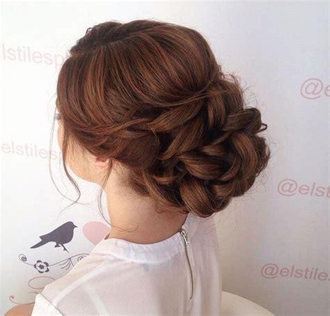 low bun textured updo messy bun loose curls bridal