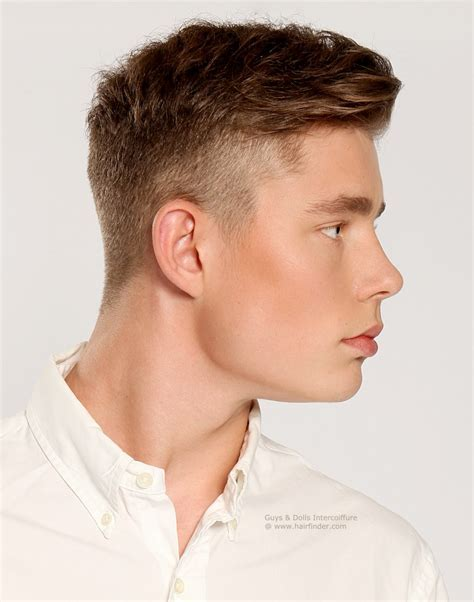 Clean retro haircut with short buzzed sides and longer
