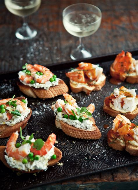 what ate 187 fresh prawn crostini with caper green olive and goat s cheese paste baby peas