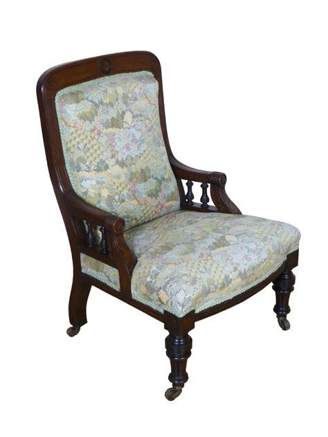 antique walnut upholstered aesthetic fireside or