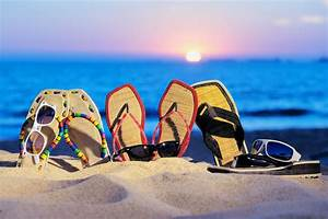 sea beach sand flip-flops sunglasses sunset summer ...