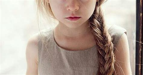 Beautiful Little Girl With A Long Blonde Braid And A White