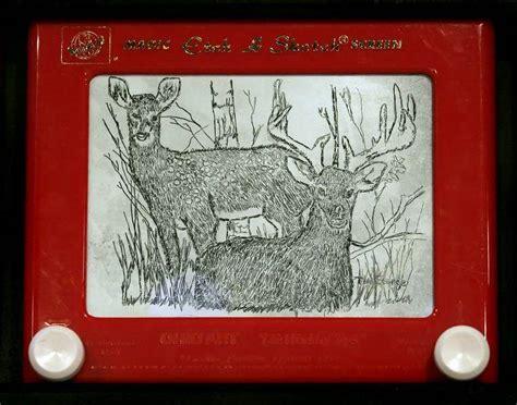 etch  sketch draws em   blade