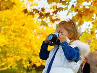 Child Taking Picture with Camera