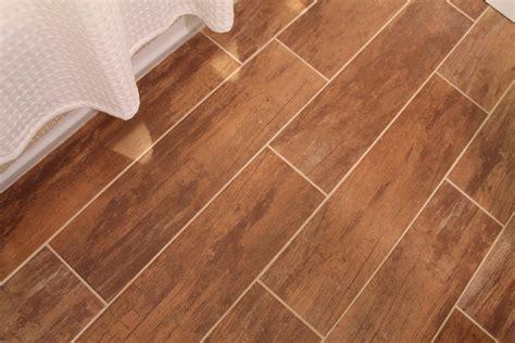 remodelaholic bathroom renovation  wood grain tile