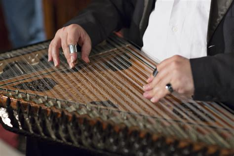 Cute young male arab enjoys sound of guitar, sitting on hill in. Discover These Arab Music Instruments - The life pile